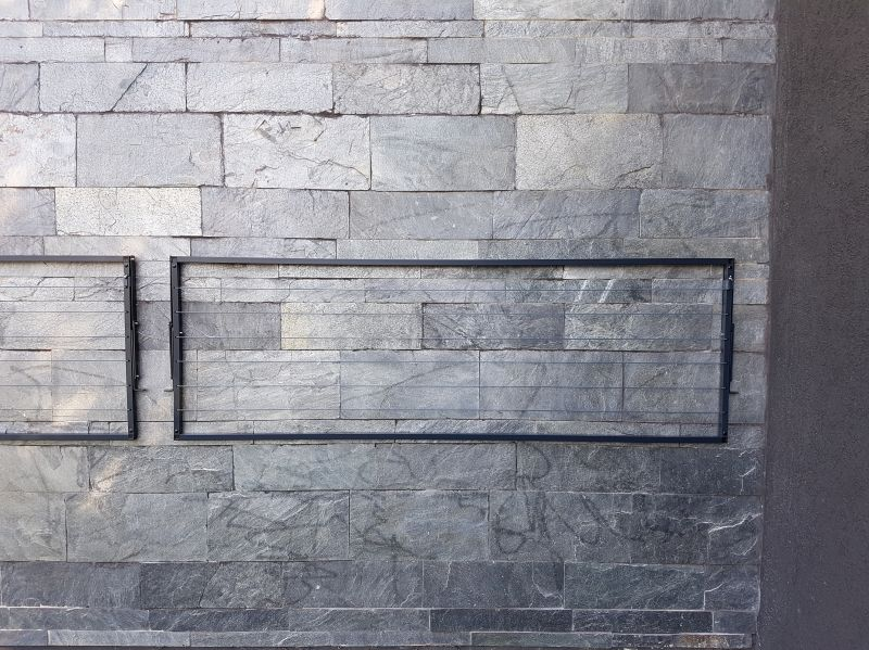 Charcoal colour blends in with this wall